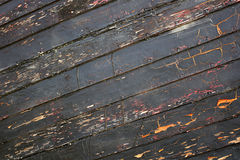 Background of tarred boards. Background from the bottom of the old boat Royalty Free Stock Photo