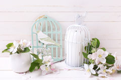 Background with tender apple blossom and candle in decorative bi Stock Photo