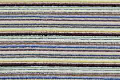 Background terry, fluffy fabric in bright stripes royalty free stock photos