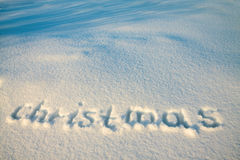 Background from text Christmas on snow Royalty Free Stock Photos