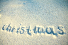 Background from text Christmas on snow Stock Image