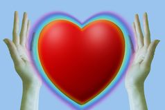 Background for text or collage. Happy Valentine`s Day. Rainbow heart between the palms on a light blue background. royalty free stock image