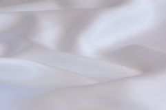 Background textile. White satin textile material background Stock Photography