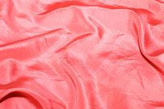 Background textile. Red satin textile material background Stock Photo