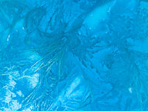 Background Texture. Frozen Coloured Background featuring blue ice patterns Stock Photos