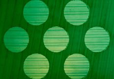 Background texture gradations and circle pattern on green plastic Royalty Free Stock Photography