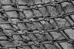 Background Texture Abstract Pattern - Lobster Pot Net. Diamond patterns of net abstract, with rope and knots tied from a lobster pot, natural sand in background stock photos