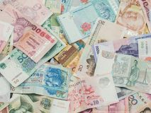 Background and texture of Asia money. Currency of Kazakhstan, Hong Kong, Indonesia, Malaysia, China, Thai and Singapore Royalty Free Stock Photos