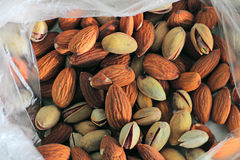 Background texture of assorted mixed nuts including almonds and pistachio Stock Photo