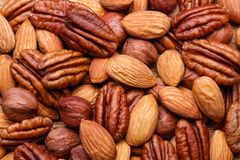 Background texture of assorted mixed nuts including cashew, peca Stock Photos