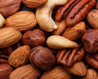Background texture of assorted mixed nuts including cashew, peca Stock Images