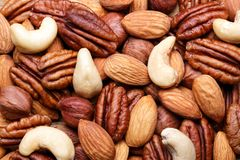 Background texture of assorted mixed nuts including cashew, peca Stock Photography