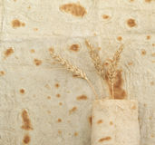 Background texture of baked lavash and ears of wheat Stock Photos