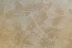 Background texture of beige gold plaster walls Stock Photos
