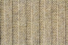 Background texture of beige pattern knitted fabric made of cotto Royalty Free Stock Image