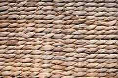 Background texture of beige or straw colored wicker or seagrass.  Stock Image