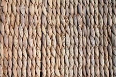 Background texture of beige or straw colored wicker or seagrass.  Stock Photography