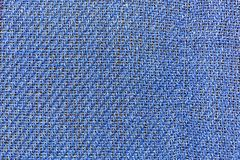 Background, texture, blue fabric closeup with interwoven strands. Interwoven threads of blue fabric closeup background, texture Royalty Free Stock Photo
