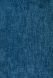 Background texture of blue jeans. Background texture of blue denim with a worn Stock Photos