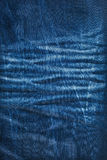 Background texture of blue jeans with pleats Royalty Free Stock Photography