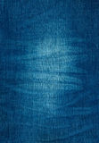 Background texture of blue jeans with pleats and scuffed Royalty Free Stock Photos