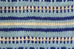 Background texture of blue pattern knitted fabric made of cotton Stock Photos