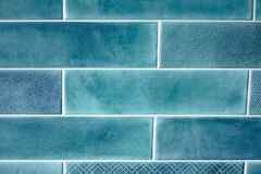 Background and texture blue rectangular tiles. Background and texture of blue rectangular tiles with a pattern on some tiles Stock Photos