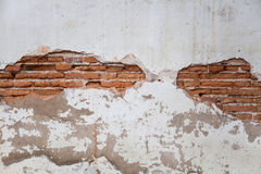 Background texture from brick wall with cracked plaster Royalty Free Stock Photos