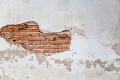 Background texture from brick wall with cracked plaster Royalty Free Stock Images