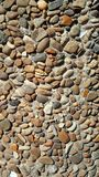 Background texture brown pebbles  in a concrete wall stock photography