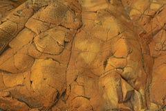 Background texture of brown, reddish rock. Texture of Brown, reddish, cracked rock as background Stock Photo