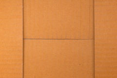 Background, texture of the cardboard is corrugated. The background, texture of the cardboard is corrugated pattern of brown paper box Royalty Free Stock Image