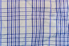 Background, texture of a checkered gray fabric with blue stripes Royalty Free Stock Images