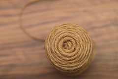 Background texture of a circle of a coil of natural hemp rope on a wooden table royalty free stock images