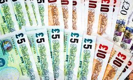 Background wallpaper fanned out British pounds Royalty Free Stock Images