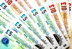 Background wallpaper fanned out British pounds Royalty Free Stock Photography