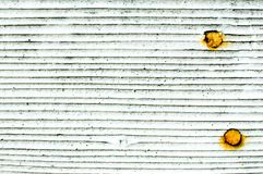 Background texture white wall shingles with rusted nails. Background texture close up of dirty white wall shingles with 2 rusted nails Royalty Free Stock Images