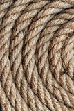 Background texture of coiled rope. With an overhead view of concentric circles of neatly coiled rope showing natural fibre texture and intertwined spiral Stock Photography