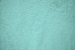 Background, texture, colored sea-green textile stock photo