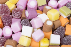Background texture of colorful chewy candy. Background texture of assorted colorful chewy candy in a concept of childhood treats and unhealthy diet rich in sugar stock photography