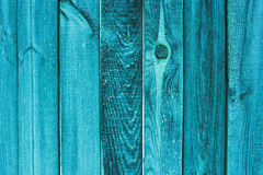 Background and texture concept old wooden turquoise fence. Or door painted. Vintage wooden background texture stock photo