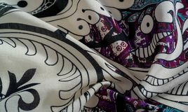 Background texture. cotton women scarf black and white pattern on one side of the scarf and color paisley pattern on the other