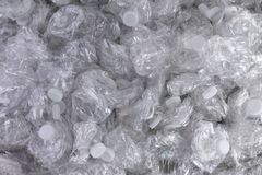 Background texture of crumpled plastic bottles. Background texture of crumpled crushed clear plastic bottles piled in a heap ready for recycling to save the royalty free stock images