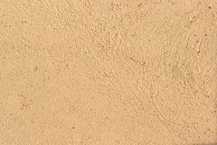Background texture of decorative plaster shades of beige or light brown. Texture of stucco. Beige wall texture background. Beige or light brown decorative royalty free stock photos