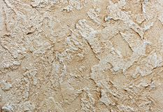 Background and texture of decorative plaster to cover the walls and ceilings. Background for design and decoration.  royalty free stock photography