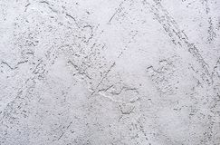 Background and texture of decorative plaster to cover the walls and ceilings. Background for design and decoration.  royalty free stock images