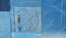 Background texture of denim fabric with pockets and stitched seams with buttons and rivets from different pieces of jeans. Royalty Free Stock Image