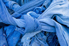 Background texture of denim fabric with pockets and stitched seams with buttons and rivets from different pieces of jeans Stock Photos