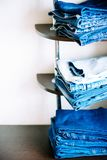 Stack of jeans. Background, texture: denim stack things on the shelves of the Cabinet royalty free stock photography