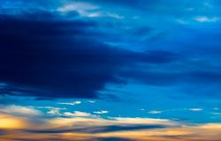 Background texture of dramatic sunset sky with clouds after thunderstorm Royalty Free Stock Image
